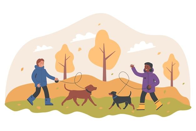 Pessoas passando um tempo juntas com seus animais de estimação no outono