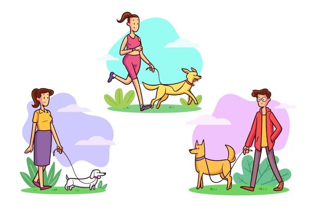 Pessoas passeando com a coleção de cães
