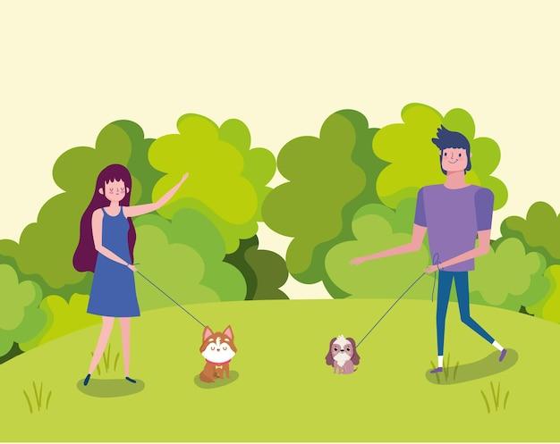 Pessoas passeando com cachorros