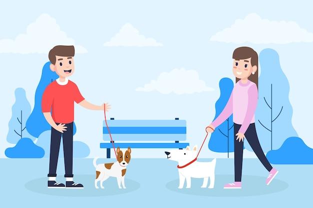 Pessoas passeando com cães no parque