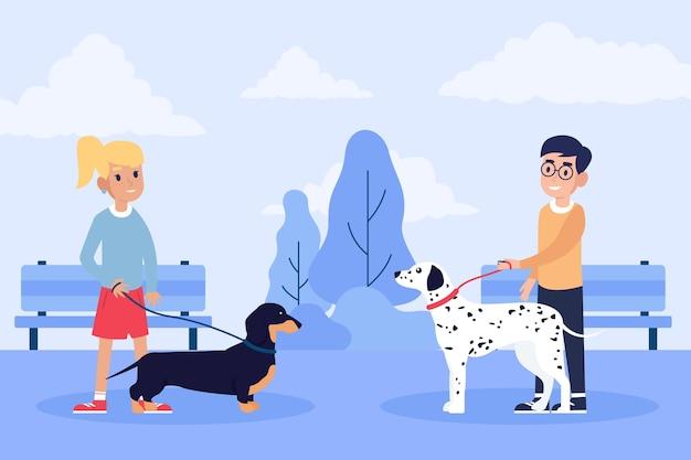 Pessoas passeando com o cachorro na natureza