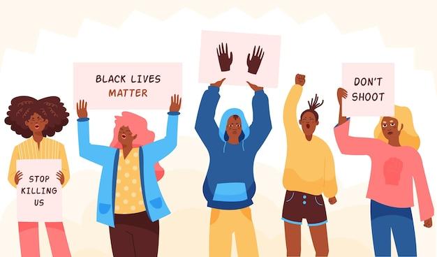 Pessoas protestam contra o racismo com mensagens em cartazes