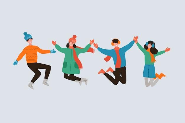 Pessoas pulando em roupas de inverno