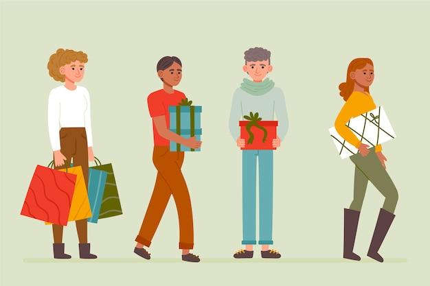 Pessoas que compram conjunto de presentes de natal