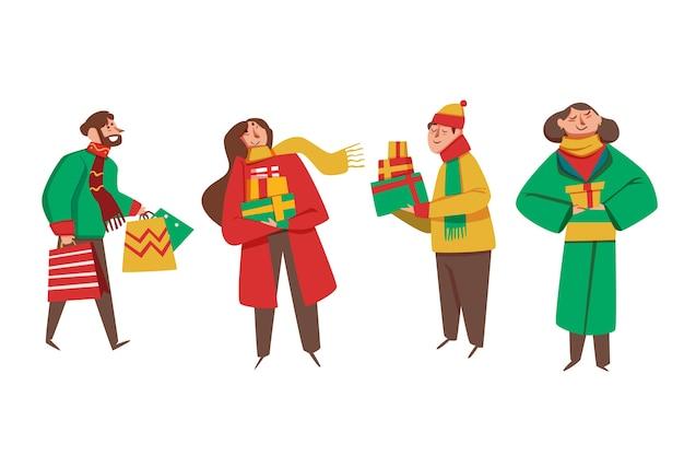 Pessoas que compram presentes de natal em fundo branco