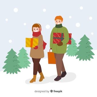 Pessoas que compram presentes de natal juntos