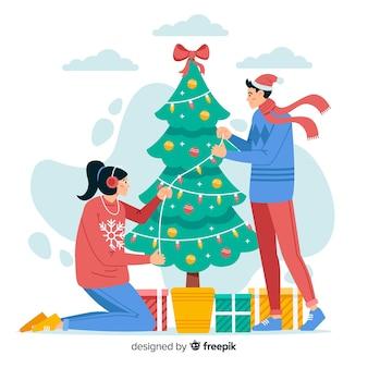 Pessoas que decoram a árvore de natal juntos