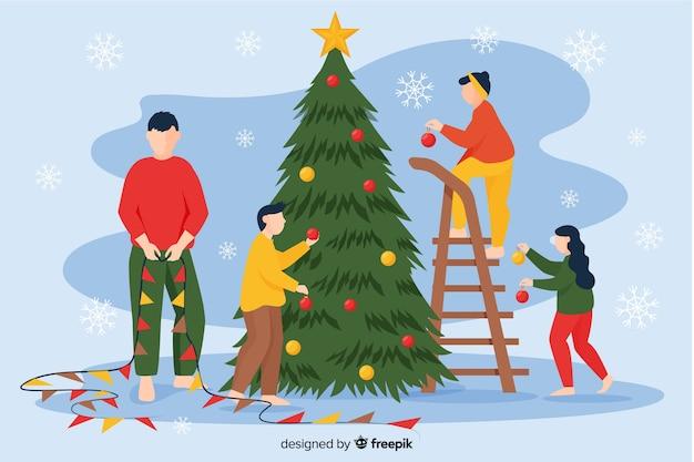 Pessoas que decoram o fundo da temporada de inverno da árvore