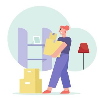Pessoas que mudam de casa carregando caixa