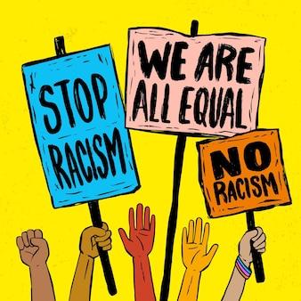 Pessoas que protestam contra o racismo com cartazes
