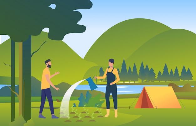 Pessoas regando e plantando árvores na natureza selvagem
