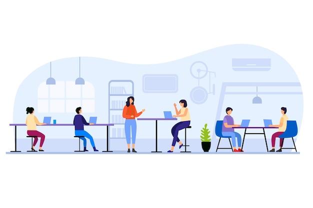 Pessoas sentadas em mesas em um espaço de coworking