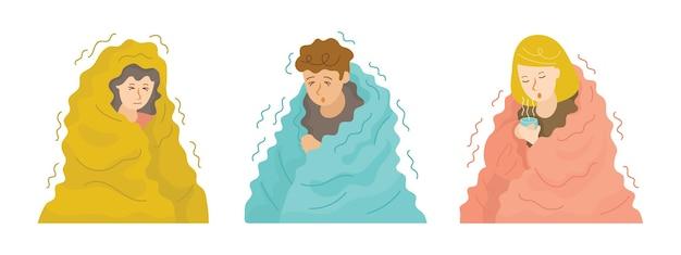 Pessoas tremendo sob o cobertor