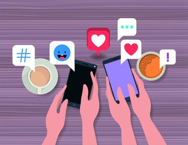 Pessoas usando smartphone com xícara de café e ícones sociais