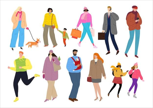 Pessoas vestidas com roupas de inverno, caminhando ao ar livre.