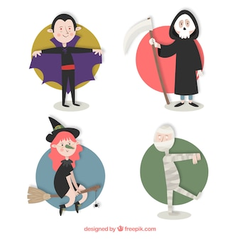 Pessoas vestidas de dracula, ceifador, bruxa e uma múmia