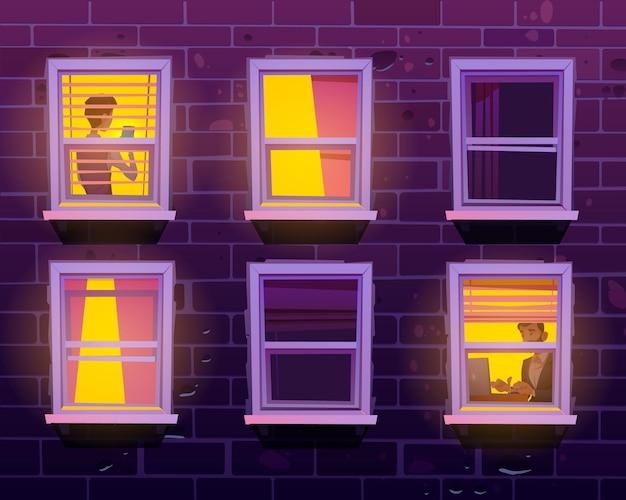 Pessoas vistas pelas janelas passam tempo com gadgets