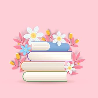 Pilha colorida de livros com flores