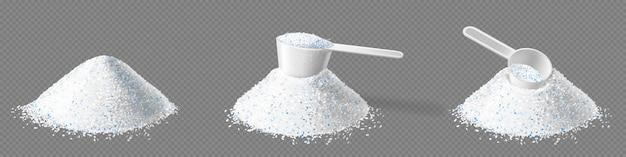 Pilha de detergente em pó e colher de medição