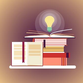 Pilha de livros com ícone de lâmpada