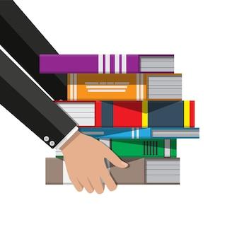Pilha de livros na mão