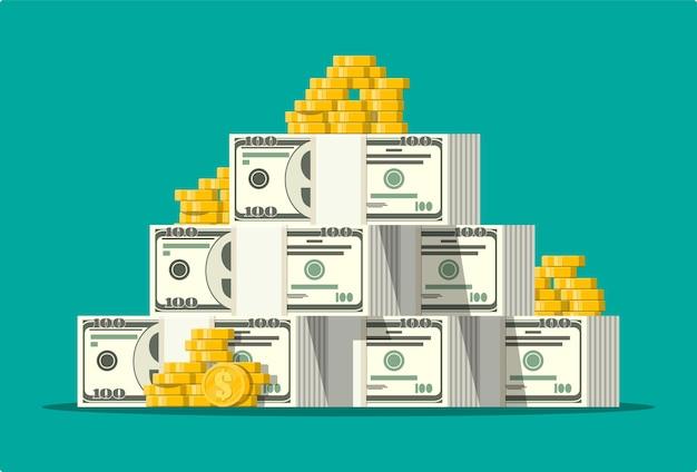 Pilha de notas de dólar e moedas de ouro