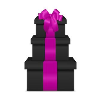 Pilha de três caixas de presente preto realista com fita rosa e arco