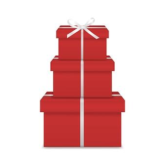Pilha de três caixas de presente vermelha realista com fita branca e arco