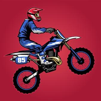 Piloto de motocross em pé anda de bicicleta