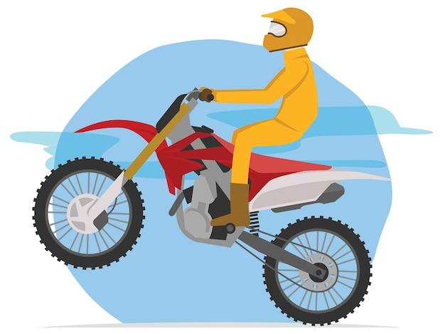 Piloto de motocross pronto para saltar