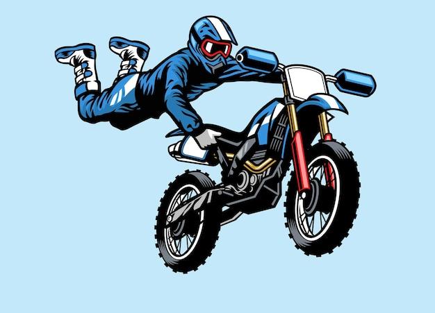 Piloto de motocross pulando na motocicleta. com truque de ataque de cervo