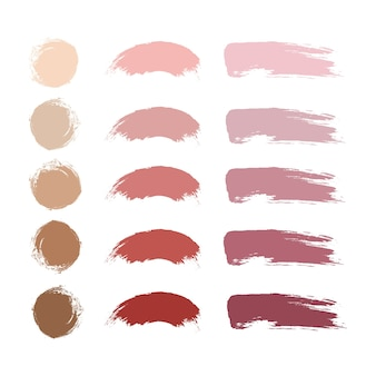 Pincéis de traço de maquiagem, batom nude, blush e pó ou amostras de base. compõem a coleção de esfregaços.