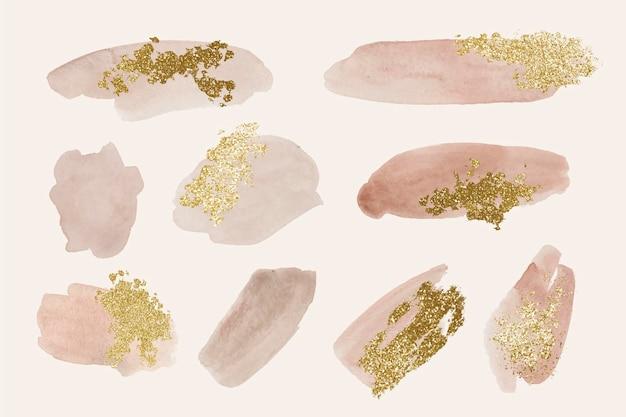 Pinceladas de aquarela pintadas à mão com ouro e glitter