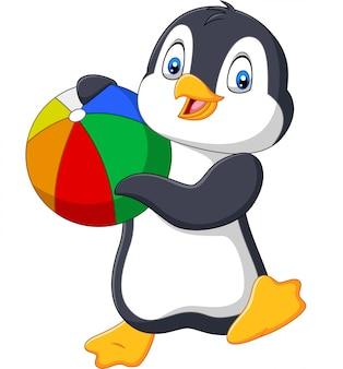 Pinguim de desenhos animados segurando bola de praia