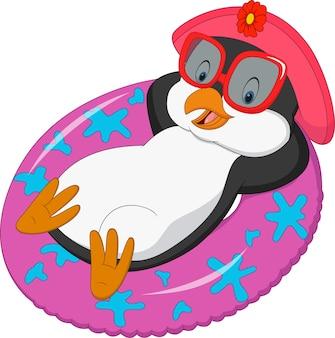 Pinguim fêmea dos desenhos animados que relaxa no anel inflável
