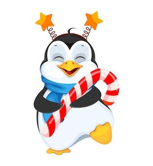 Pinguim fofo segurando um bastão de doces feliz natal e feliz ano novo
