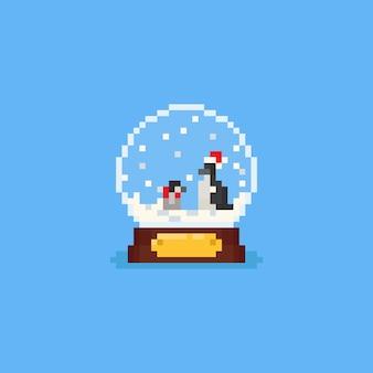 Pinguins do pixel dentro do globo da neve.