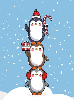 Pinguins fofos celebrando o natal com um presente