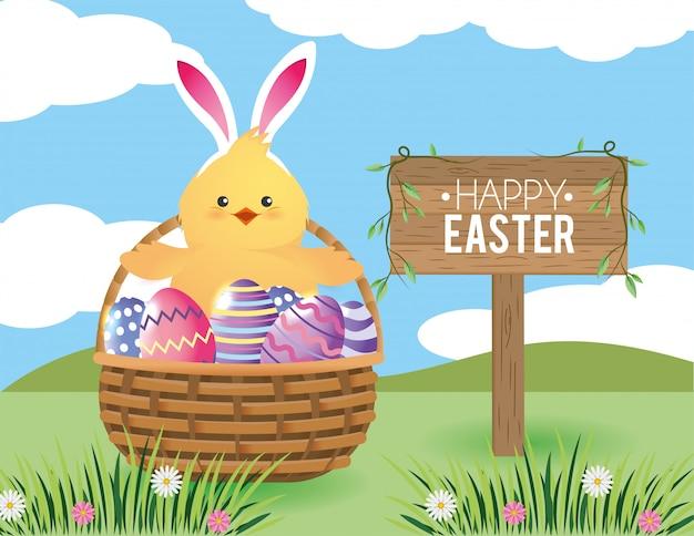 Pintinho com decoração de ovos de páscoa dentro da cesta