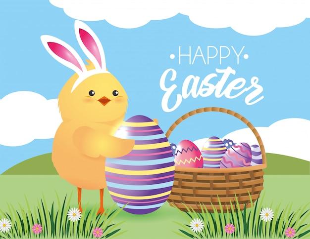 Pintinho wearin orelhas de coelho com decoração de ovos