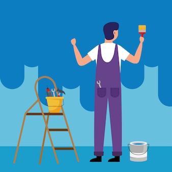 Pintor homem com pincel e ferramentas na escada