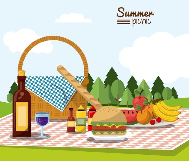 Piquenique de verão com paisagem e cesta de piquenique em toalha de mesa