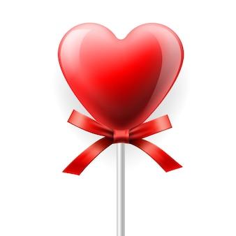 Pirulito de coração vermelho com laço isolado.