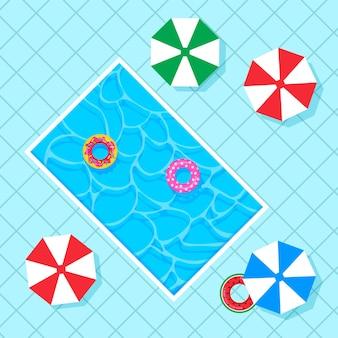 Piscina retangular com bóias salva-vidas coloridas