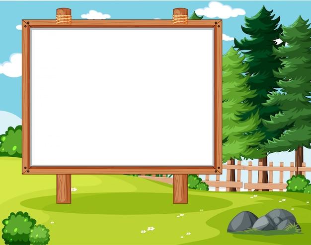 Placa de banner vazio no cenário do parque natural