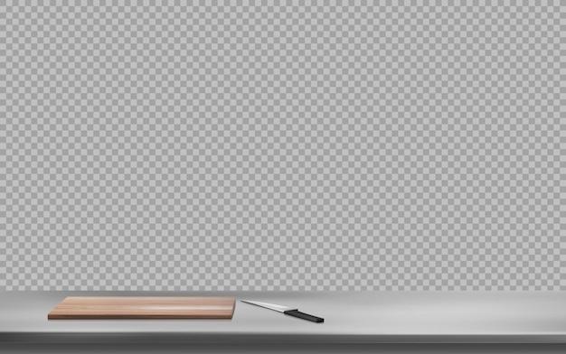 Placa de corte e faca na superfície da mesa de aço