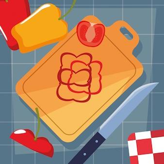 Placa de cozinha com legumes e faca