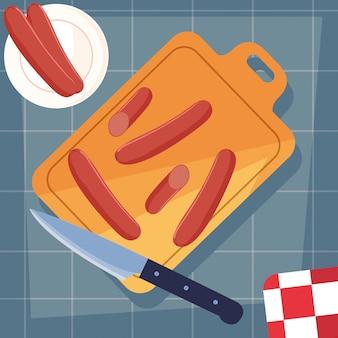 Placa de cozinha com salsichas e faca
