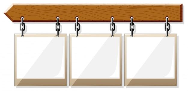 Placa de madeira com molduras vazias
