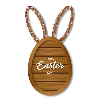 Placa de madeira em formato de ovo de páscoa com orelhas de coelho